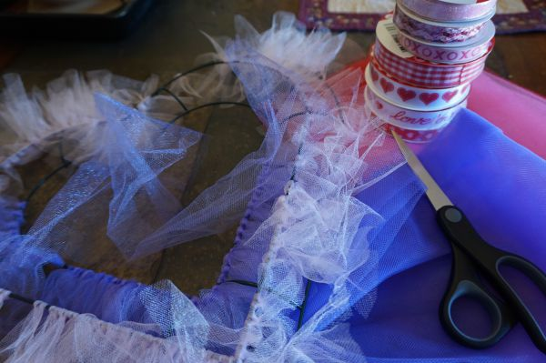 Tying tulle onto the wire form.
